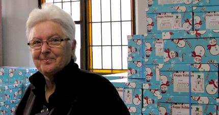 Elf Clare joyfully helps sort boxes