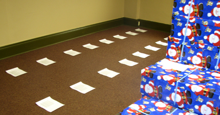 Route lists on the floor ready for moving boxes into piles